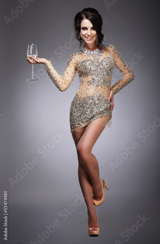 Happy Gorgeous Woman Holding Wineglass of Champagne