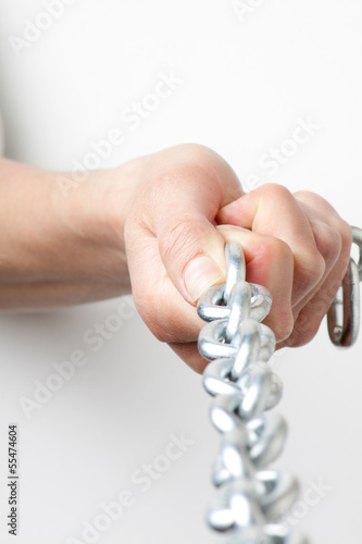 hands holding a chain