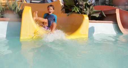happy child boy having fun in aqua park