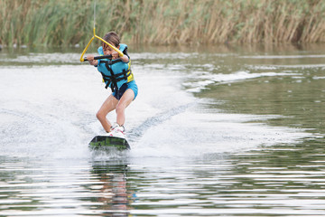 young child boy wake boarding