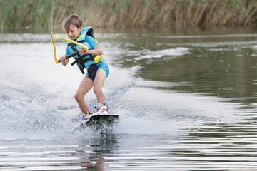young child boy wake boarding