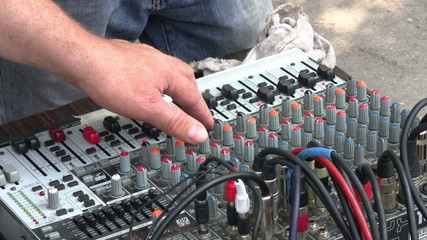 Sound engineer working on mixer