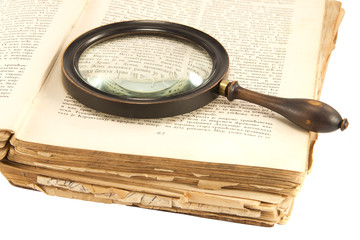 Old book and the magnifying glass