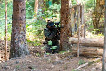 Paintball Player Hide Behind Tree