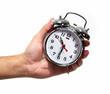 Leinwanddruck Bild Hand with alarm clock.