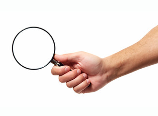 Hand with magnifying glass loupe.