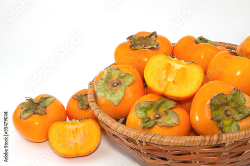 Fresh Persimmon fruit in the basket