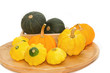 Yellow Patty Pan And Pumpkin on the wooden tray