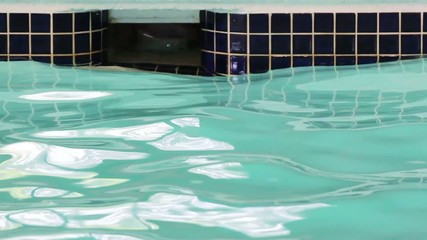 Swimming pool wall filter with rippling water