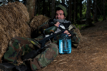 Paintball player resting on the ground