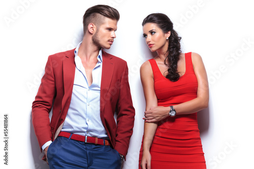 casual fashion man and woman looking at each other