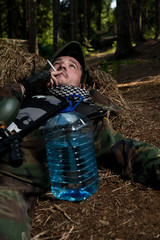 Paintball player resting and smoking a cigar