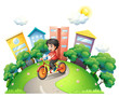 A boy biking at the road going to the high buildings
