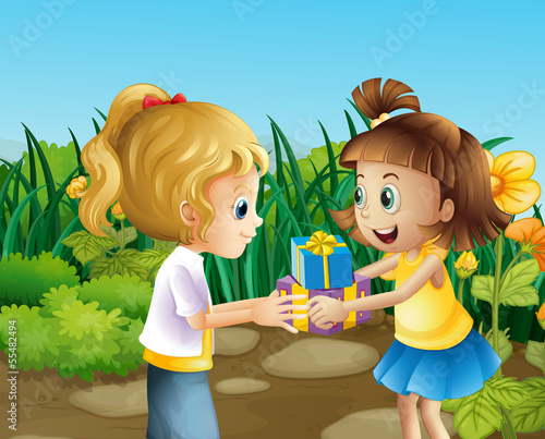 Two friends exchanging gifts outdoor