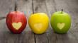 Leinwanddruck Bild - Apples with engraved hearts