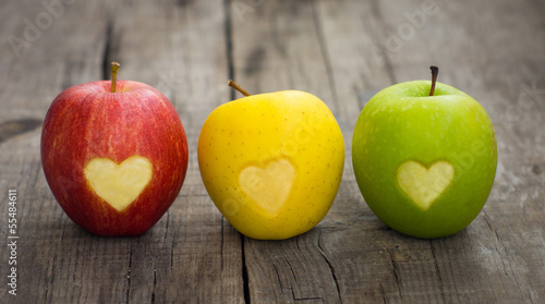 Staande foto Vruchten Apples with engraved hearts