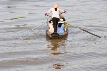 Woman rowing boat at Mekong delta, Chau Doc (Vietnam)