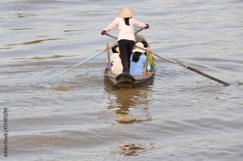 Woman rowing boat at Mekong delta, Chau Doc (Vietnam)