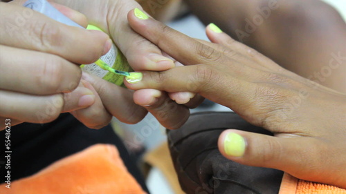 Yellow Paint On Finger Nails During Manicure
