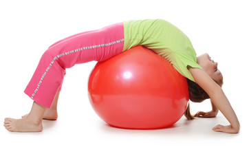 Little girl on a gymnastic ball