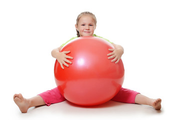 Little girl with a gymnastic ball