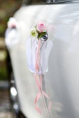 Wedding car decorated with pink rose
