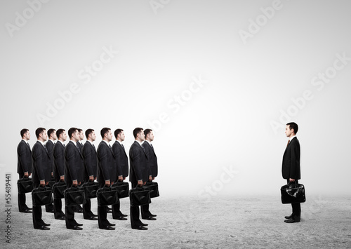 many businessmen with briefcase
