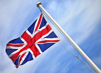 A union jack flag flying in a clear blue sky