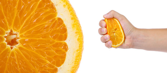 Hand press orange and macro slice.