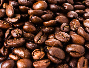 Roasted brown coffee beans  background or texture closeup
