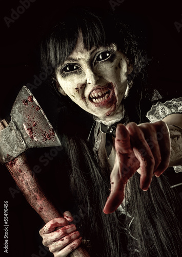 Female zombie with bloody axe