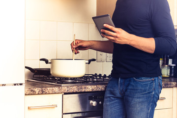 Man following recipe on digital reader