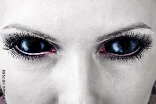 Evil black female zombie eyes.