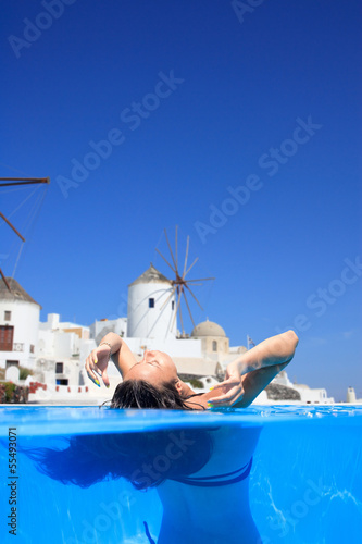 woman enjoying the view of Santorini