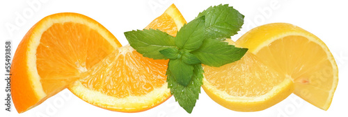 Sliced oranges and lemon with mint leaves.