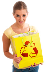 Young woman holding recycle paper bag.