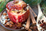 baked apple with christmas spices on wooden background