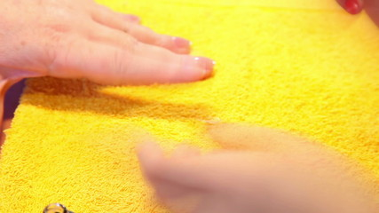 Visagist making manicure to a model. Close-up. Time lapse.