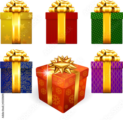 Colored and decorated shining gift boxes with golden ribbon