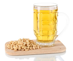 Beer in glass and nuts on on board isolated on white