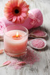 Beautiful spa setting with pink candle and flower