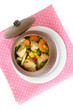 Baked mixed vegetable with chicken breast in pot, isolated