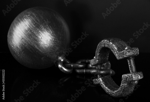 Ball and chain on black background