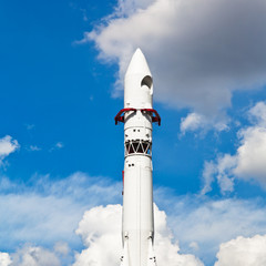 rocket Vostok and blue sky with clouds