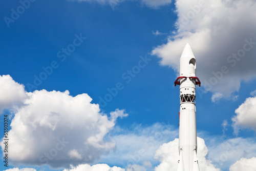 space rocket Vostok and blue sky with clouds