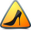 Warning sign with woman shoe