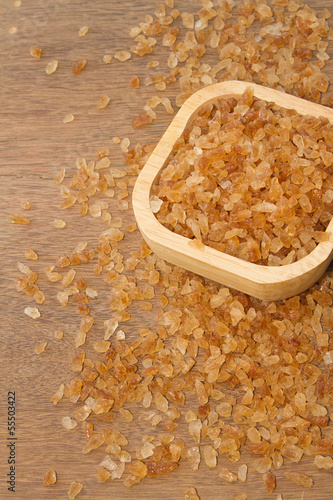 Organic rock candy sugar in wooden bowl