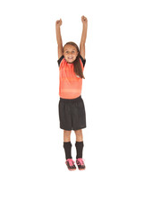 Girl in soccer football uniform jumping up for joy