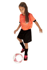 Girl in pink jersey kicking soccer ball with foot