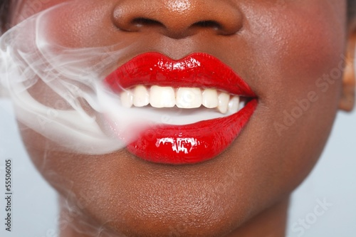 Beautiful Lips of a Woman With Cigarette Smoke